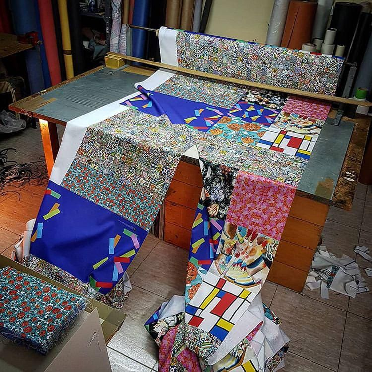 Cutting fabric at the Celler de la Pell