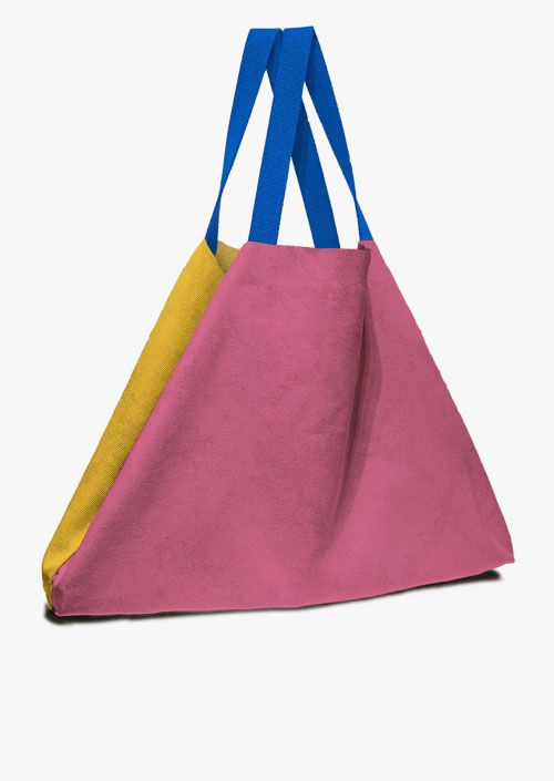 Large format bag in fuchsia and mustard colors, with blue handles